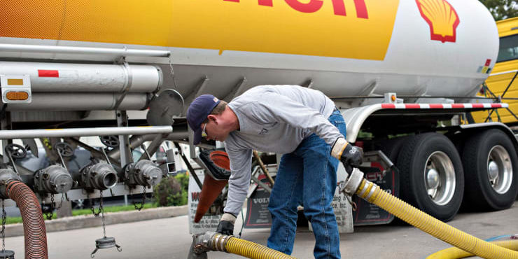 A driver delivers 7,500 gallons of unleaded gasoline to a Shell station in Peoria, Illinois. Daniel Acker | Bloomberg | Getty Images